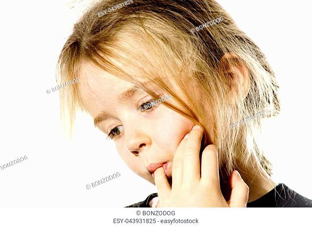 Disheveled preschooler girl with long hair thinking, isolated on white background