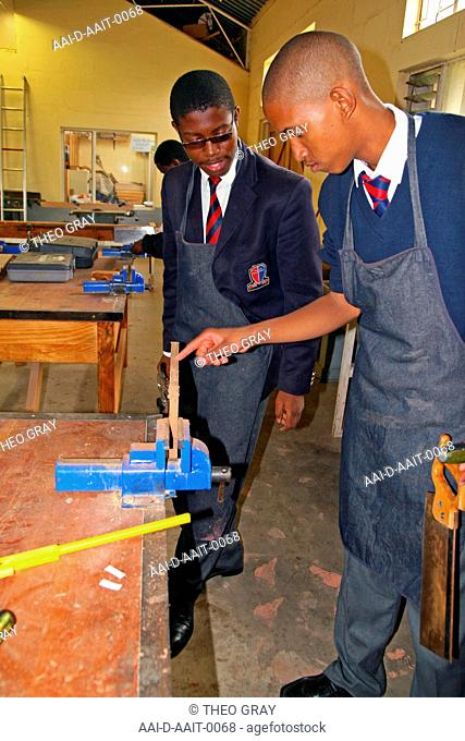 School boys clamping wood in woodwork classroom, St Mark's School, Mbabane, Hhohho, Kingdom of Swaziland