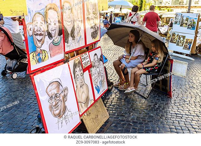 Two girls sit while posing for a caricature painter in Piazza Navona, Rome, Lazio region, Italy