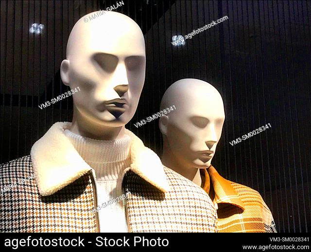 Two mannequins in a shop window. Madrid, Spain