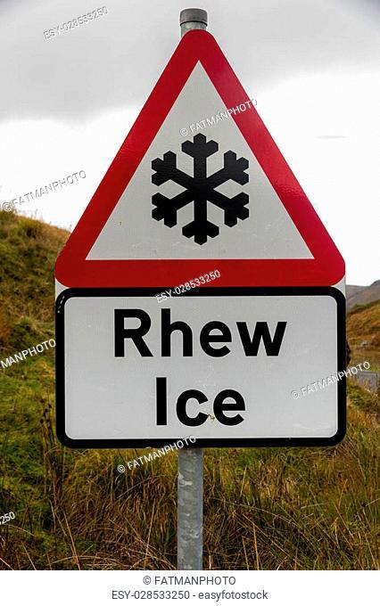 Snowflake triangular warning sign, Wales, warning of Ice, Welsh bilingual Rhew, United Kingdom