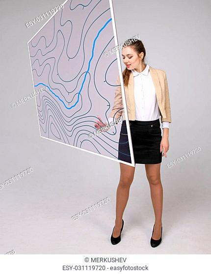 Geographic information systems concept, woman scientist working with futuristic interface in GIS software on a transparent screen