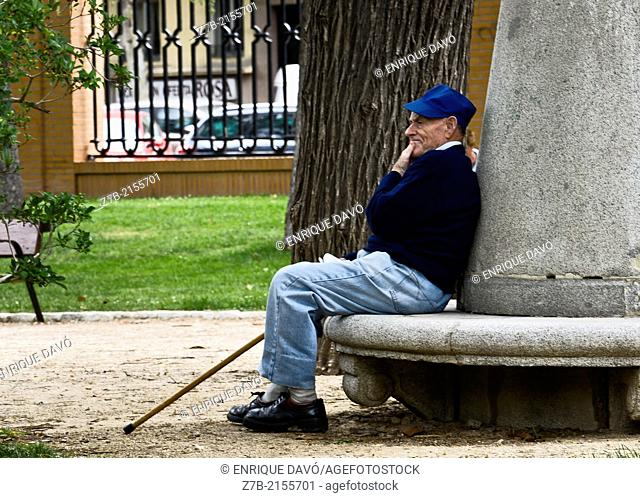 A man with a blue jersey in the Retiro park, Madrid city, Spain