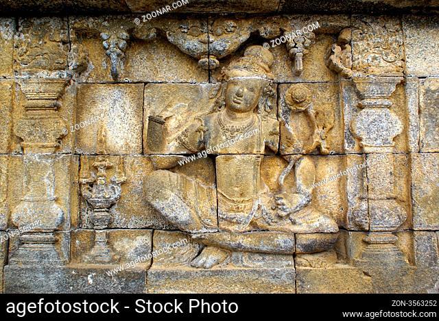 Woman on the wall of Borobudur, Java, Indonesia