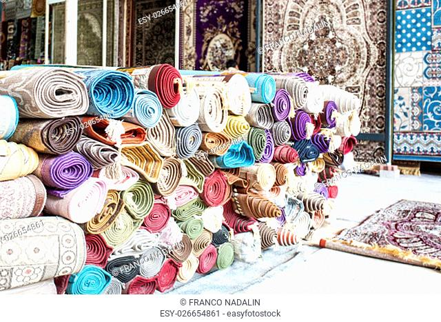Many colorful carpets for sale in the store