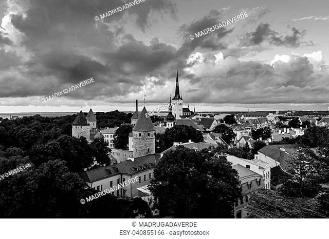 Tallinn, Estonia. Aerial view of Tallinn old town, Estonia. Red rooftops with colorful cloudy sky. Popular landmark in Baltic region. Black and white