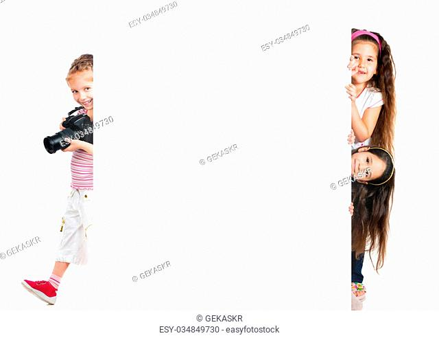 Funny little kids with big white banner