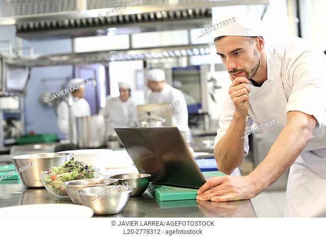 Chef with laptop computer, Cook in cooking school, Cuisine School, Donostia, San Sebastian, Gipuzkoa, Basque Country, Spain, Europe