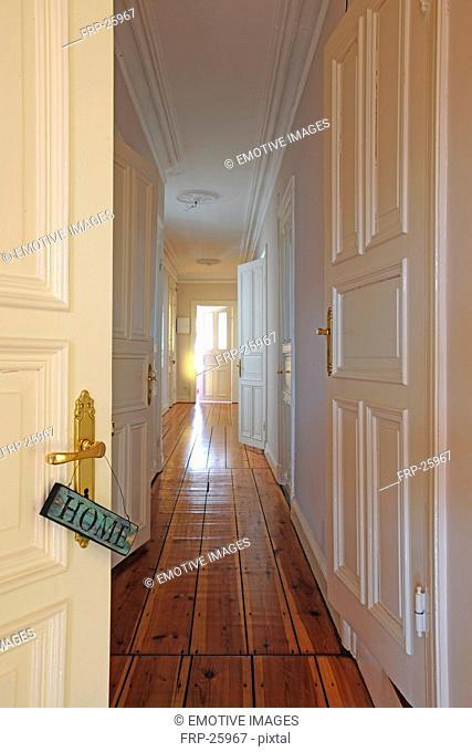 Home sign at door knob and floor