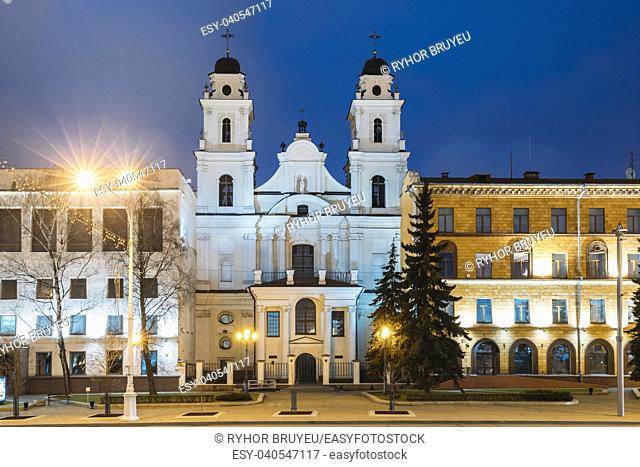 Minsk, Belarus. View Of Cathedral Of Saint Virgin Mary And Part Of Building Of French Embassy In Republic Of Belarus In Evening Night Illuminations