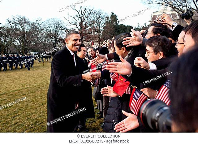 President Obama and Chinese President Hu Jintao greet guests on the South Lawn of the White House Jan. 19 2011. BSWH-2011-8-217
