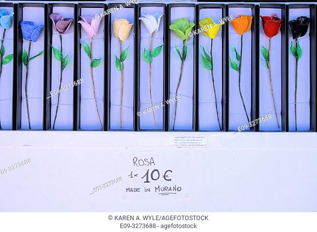 glass roses in many colors, on display at shop on island of Murano near Venice, Italy
