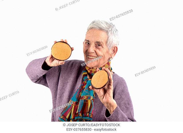 senior woman eating cookie. on white background