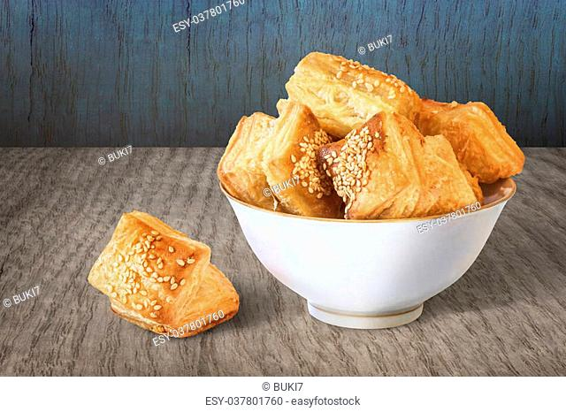 Photograph of Porcelain Bowl of Croissant Pastry Zu-Zu on rustic Wooden Table