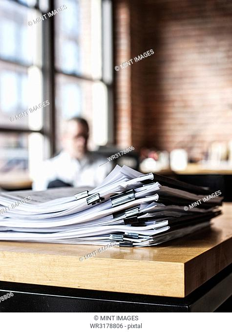 Close-up of files and file folders on a desk top in an office