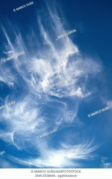 The play of wind with clouds in blue sky