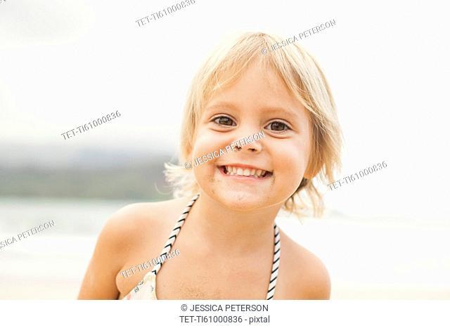 Baby girl (2-3) on beach
