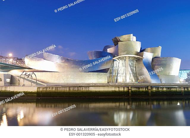 Bilbao, Biscay, Basque Country, Spain, July 30, 2011: night view of the Guggenheim Museum and Nervion river at sunset  Guggenheim Museum is dedicated exhibition...