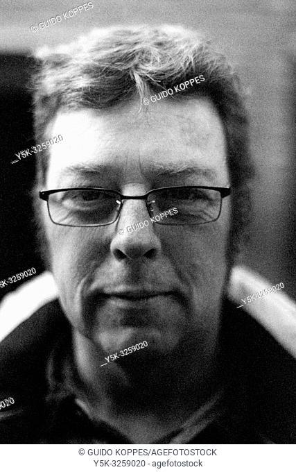 Tilburg, Netherlands. Black & White Straat Portrait in Black & White of an Adult, Caucasian Male wearing Glasses. Shot on Analog Film