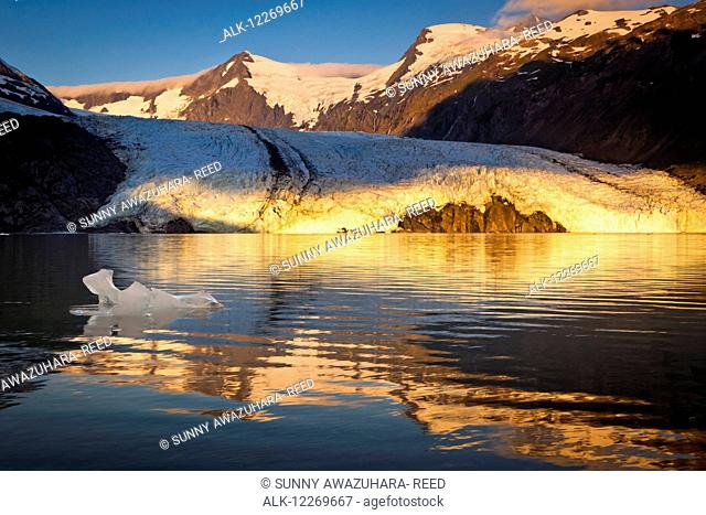 Sunrise view of Portage Glacier with icebergs and Byron Peak in the background, Chugach National Forest, Kenai Peninsula, Southcentral Alaska, Summer