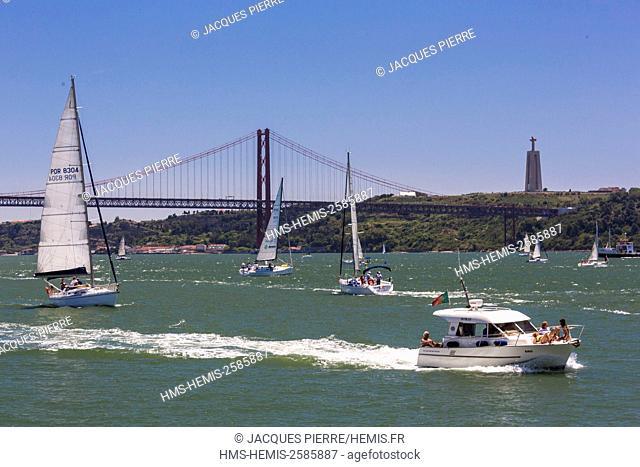 Portugal, Lisbon, district of Belem, 25 April bridge on the Tagus river, view of the Cristo Ré statue