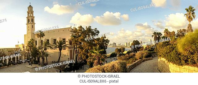 Panorama of old Jaffa with St. Peter church and Monastery on the left. Tel Aviv can be seen in the distance