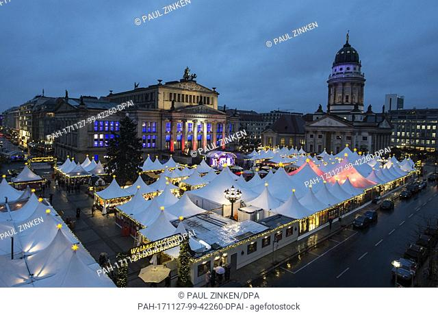 The Gendarmenmarkt Christmas market glows with light in Berlin, Germany, 27 November 2017. The Christmas market in front of the the Konzerthaus in Berlin opened...