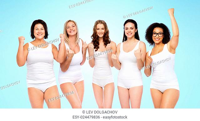success, friendship, beauty, body positive and people concept - group of happy plus size women in white underwear celebrating victory over blue background