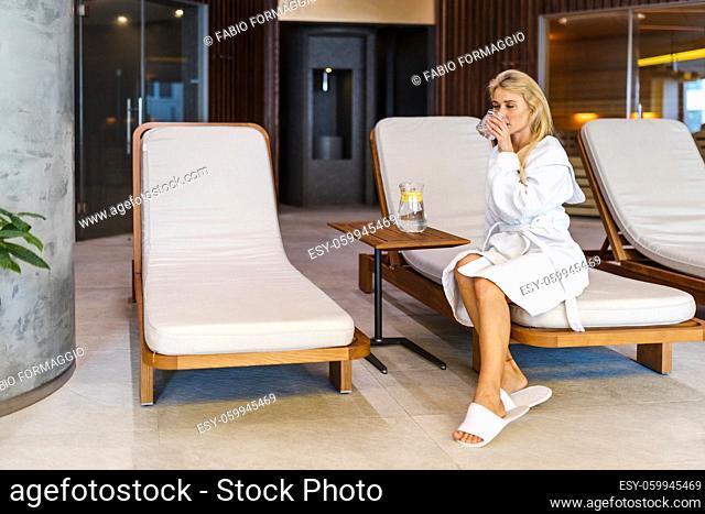 Beautiful woman relaxing in a beauty spa hotel - Client having a beauty treatment in a beauty spa salon