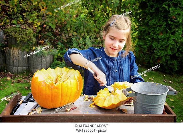 Girl carving Jack O'Lantern
