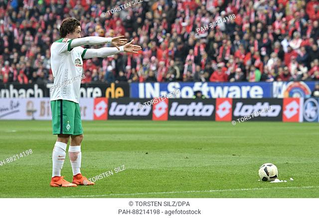Bremen's Thomas Delaney prepares to a take a free-kick in the German Bundesliga soccer match between FSV Mainz and Werder Bremen in the Opel Arena in Mainz