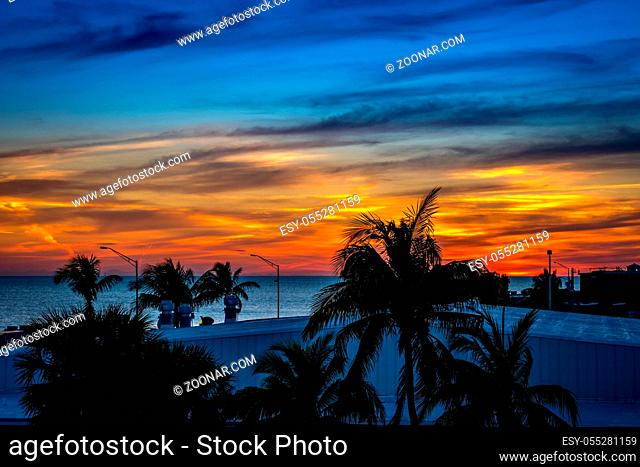 A very romantic seaside sunset with orange and blue cloudy sky in Florida Keys