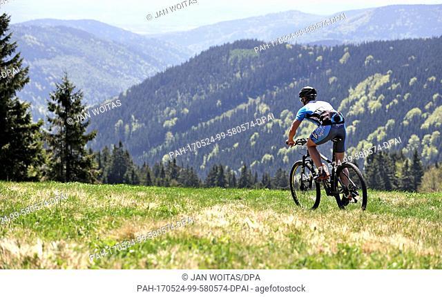 Trail keeper Toni Escher cycles along the Stoneman Miriquidi near Bozi Dar, Czech Republic, 19 May 2017. Opened in 2014, this unique mountain bike trail spans...