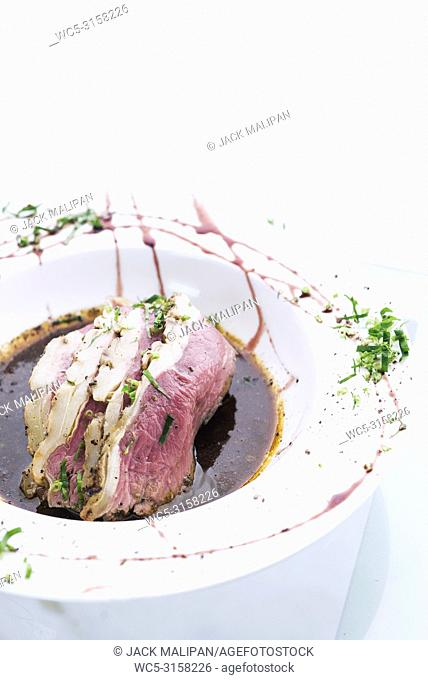 Roast beef modern fusion gourmet food cuisine meal with gravy
