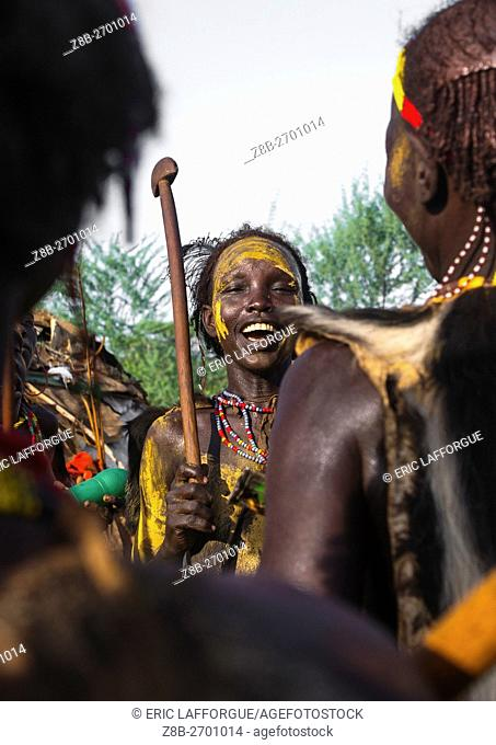 Ethiopia, Omo Valley, Omorate, dassanech tribe teenage girl dancing during dimi ceremony to celebrate circumcision of teenagers