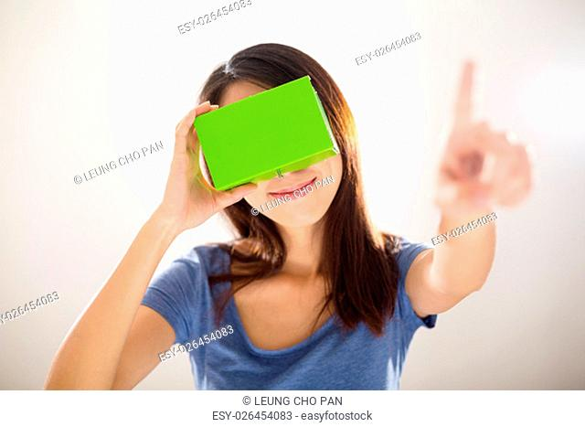 Woman looking though vr device