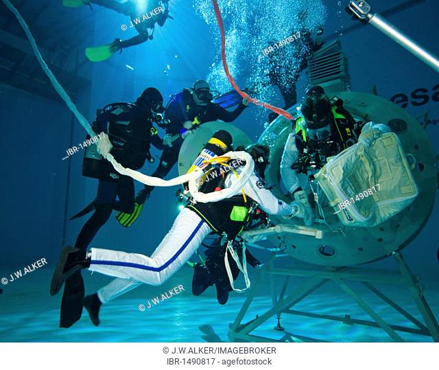 Backup divers and astronauts practicing with a space station module reproduction in a diving basin, European Space Agency, ESA, European Astronaut Center, EAC