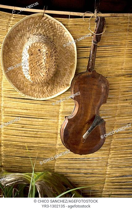 A violin and a straw hat decorate a restaurant in Cuetzalan del Progreso, Mexico, February 19, 2008  Cuetzalan is a small picturesque market town nestled in the...