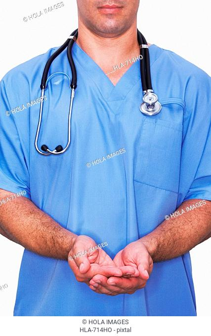 Mid section view of a male nurse with his hands cupped