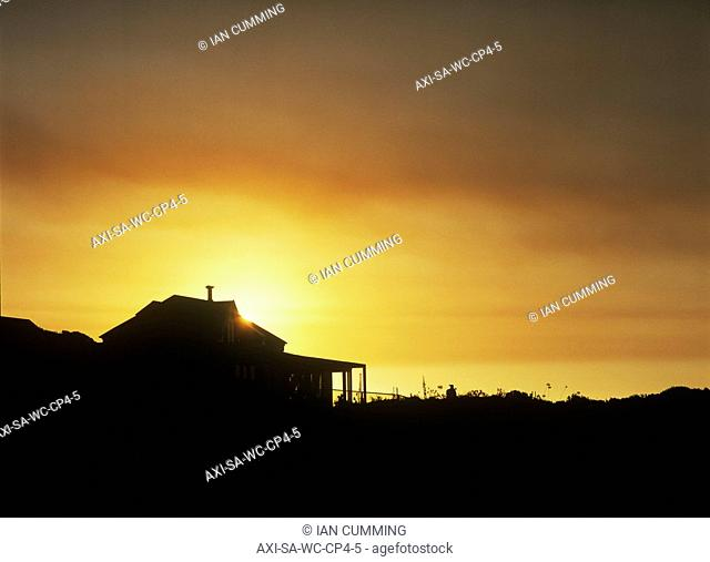 Silhouette of beach house at dusk, Kommitjie, Cape Peninsula, South Africa