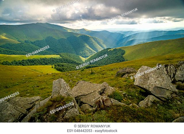 Rain clouds above Carpathians. Panorama of Borzhava ridge of the Ukrainian Carpathian Mountains