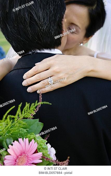 Asian newlyweds kissing