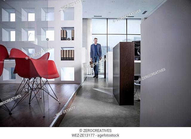 Businessman entering office