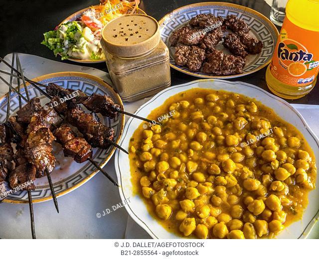 "Morocco, Food, ""Lrver Kebab"", Salad, peak peans, and ""Kefta"" (grilled mince meat) with a Fanta,.."