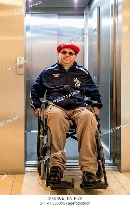 PHYSICALLY HANDICAPPED MAN IN HIS WHEELCHAIR, CHARTRES (28), FRANCE