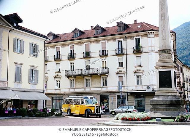 Old post bus in Independence Square, Bellinzona, Switzerland