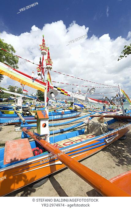 Traditional balinese fisherman boats on the beach of Jimbaran near the fish market, Bali, Indonesia