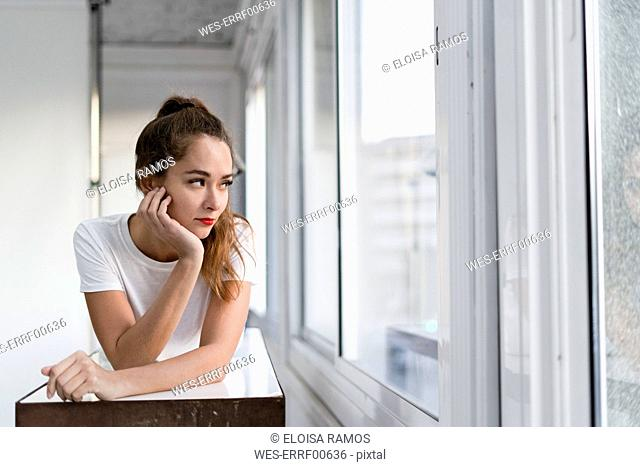 Portrait of a sexy aoung woman, lying on a bench