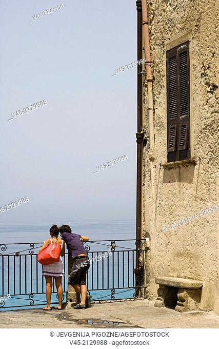 A couple enjoying the view from the terrace of Corso Vittorio Emmanuele, Tropea, Vibo Valentia, Calabria, Southern Italy, Italy