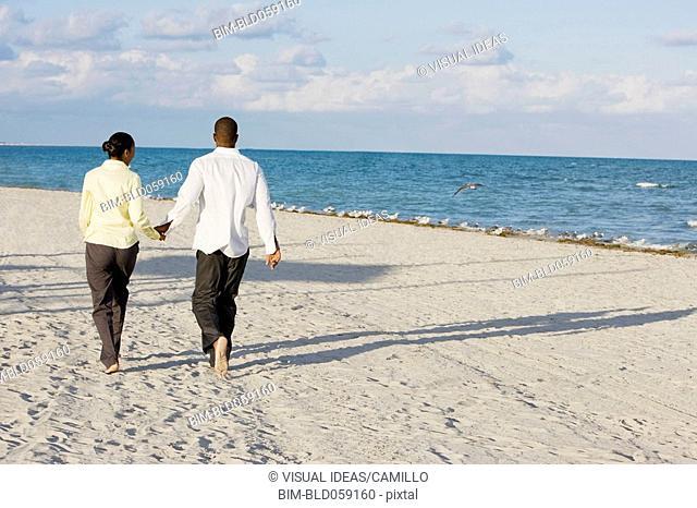 Multi-ethnic couple holding hands